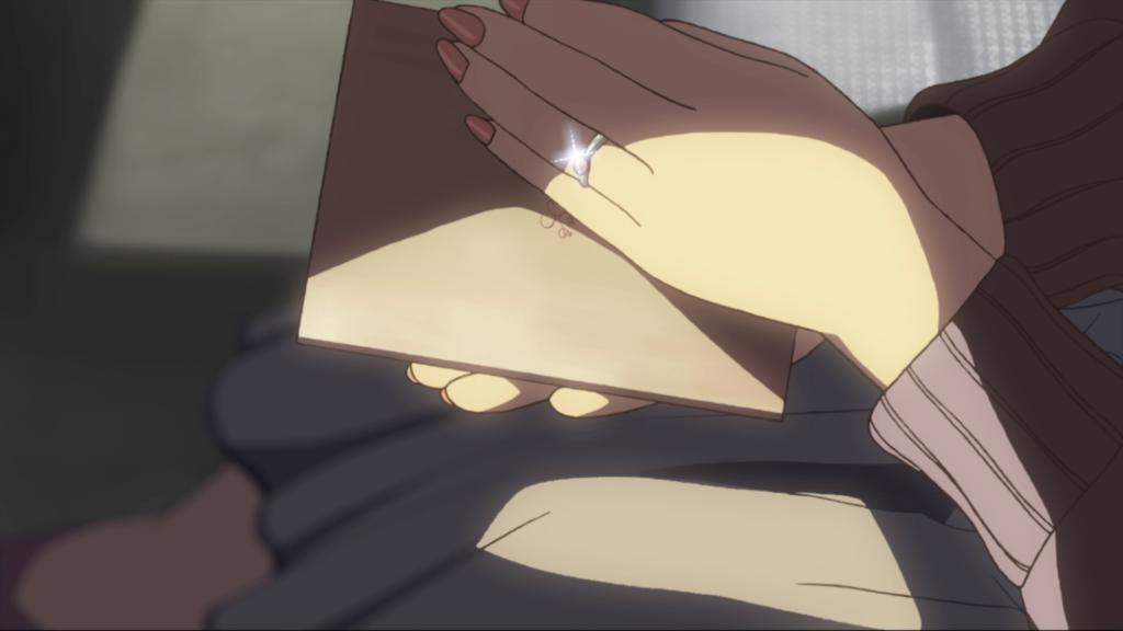 (明里の左手の薬指の指輪が光る)